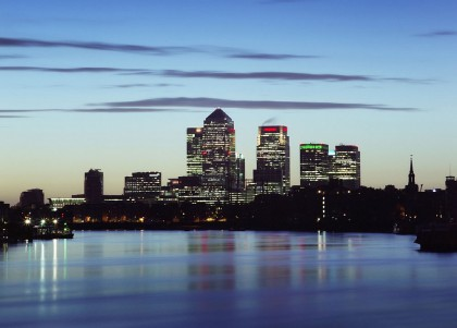 View of Thames river in London and Canary Wharf towers